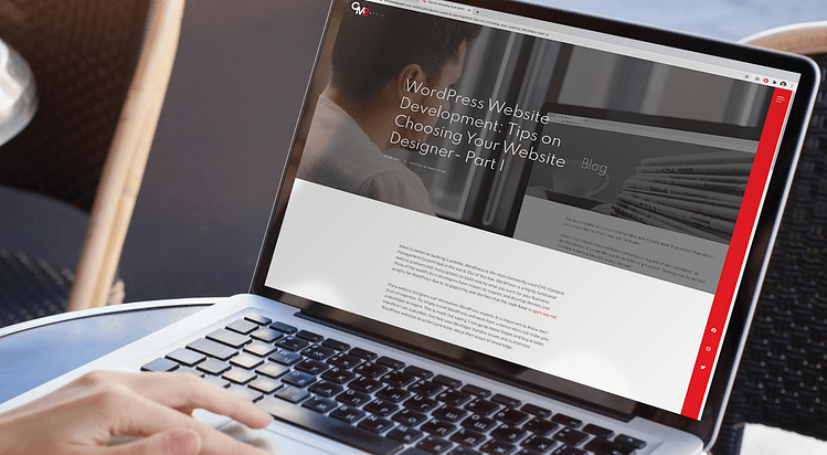 reflection of a man in the screen of a laptop - Tips on choosing a WordPress website designer