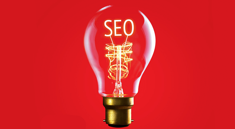 Lightbulb with a charged filament spelling SEO - the importance of image alt text in SEO