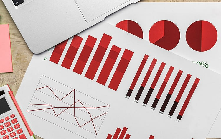 Charts and graphs scattered ona desk - 5 steps to find the right keywords for SEO